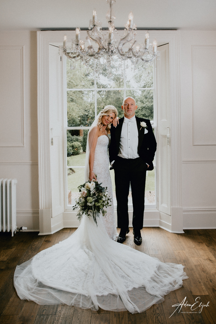 Bride and Groom in window at The Old Vicarage Boutique Wedding Venue