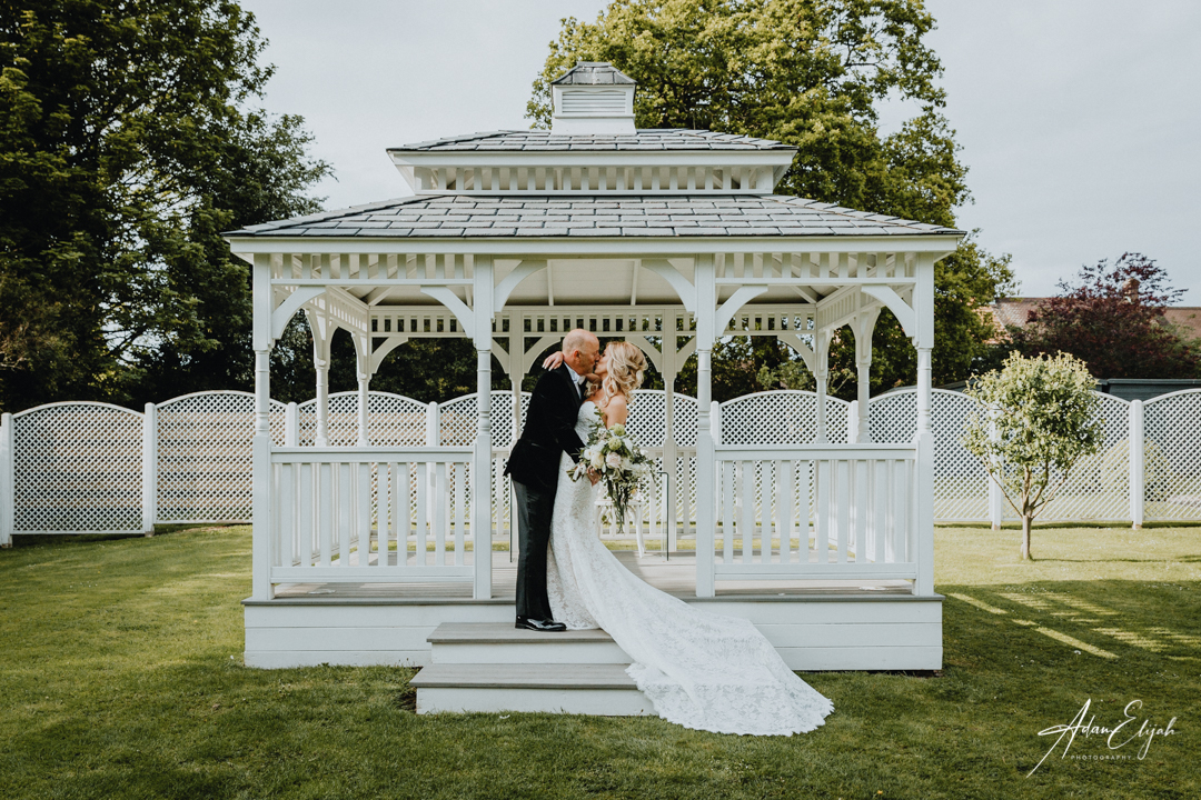 Bride and Groom in bandstand at The Old Vicarage Boutique Wedding Venue
